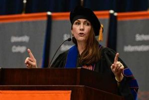 Poet Mary Karr stands a delivers an awesome graduation address at Syracuse University