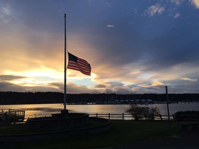 Sunset over Liberty Bay, with flag at halfmast