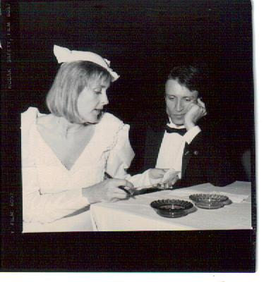 Wedding candid, 1985. Not sure precisely what is going on, but she's got a list and is checking it twice.