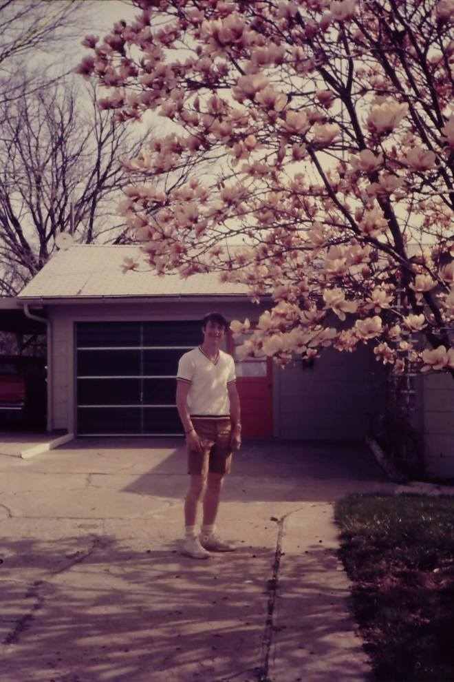 Bobby Ball standing in the DuBois' driveway, late 1960s. on Rea Street.