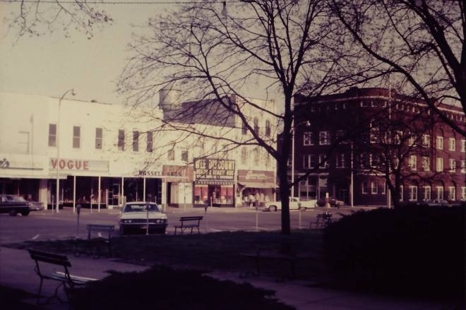 Southeast corner of the square at Marshall, Missouri. Circa 1968