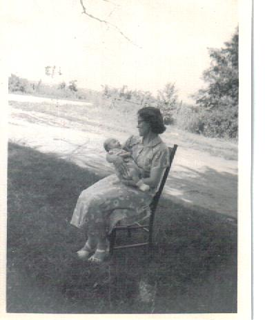 Mother holding me in 1952