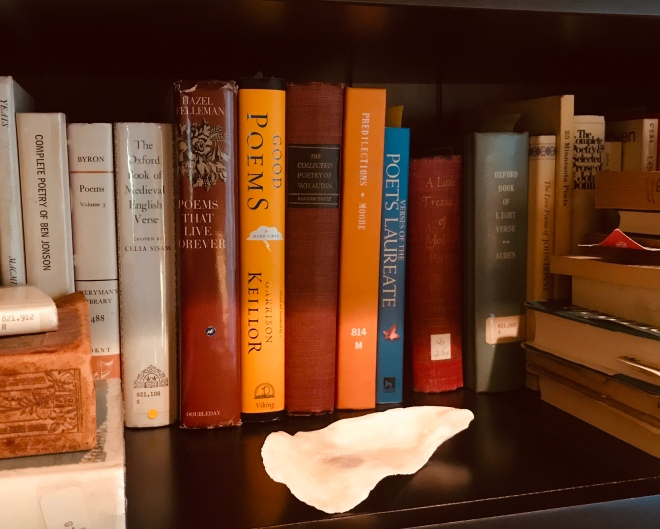 Oyster shell and books of poetry